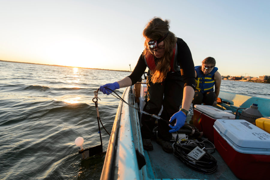 Graduate student at the University of Wisconsin-Madison collect data and water samples from Lake Mendota on a boat